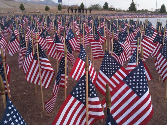 About 3,000 small U.S. flags decorate the Old Glory Memorial at Gateway North and Diana commemorating the victims of the Sept. 11, 2001, terror attacks on the U.S.