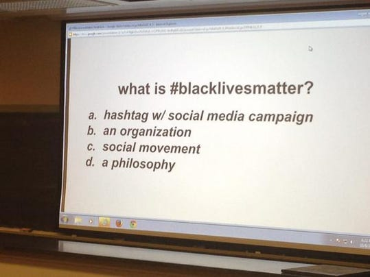 A slide shows a question Opal Tometi, co-founder of the Black Lives Matter movement, asked audience members at a presentation at Gettysburg College on Thursday. The answer, Tometi said, was 'all of the above.'