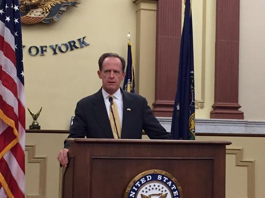 Sen. Pat Toomey talks about his bill that would increase the amount of money the Crime Victims Fund pays out to crime victims and victims-advocacy groups while at a news conference at the York County Administration building on Friday.