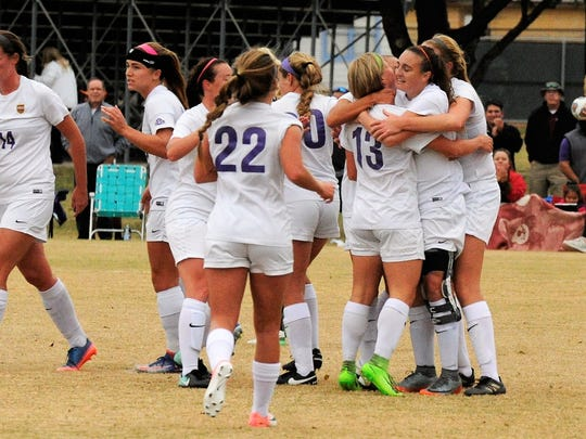 The Hardin-Simmons women's soccer team celebrates a goal against Trinity in the second round of last year's NCAA Division III tournament. With lights being added to the HSU Soccer Complex, if the Cowgirls host in the future they will have the option of playing at night instead of in the afternoon.