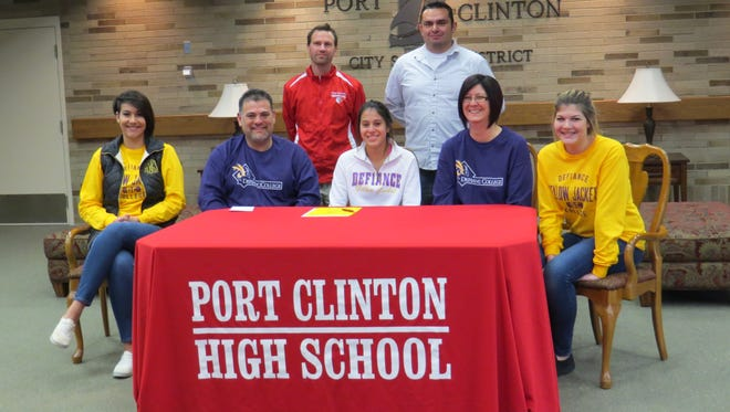 Port Clinton's Miranda Herevia, center front, will continue her soccer and track careers at Defiance. She is joined at her announcement by sister Alayne Herevia, father Dan Herevia, mother Alycia Herevia and sister Payton Herevia, left to right. Port Clinton track coach Seth Benner and soccer coach Paco Romero are in back.