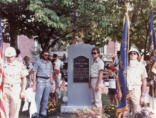 Standing in front of the Vietnam War memorial at its 1983 dedication in Berlin Borough is opne of its veterans, Robert Adair, who later helped lead an effort to add the names of those who served to the no-names monument.