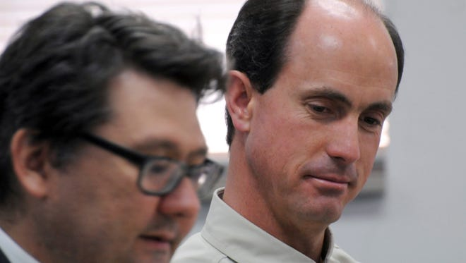 FILE - In this July 9, 2015 file photo, Seth Jeffs, right, brother of imprisoned polygamous sect leader Warren Jeffs, participates in a state water board meeting in Pierre, S.D. Jeffs, another high-ranking polygamous group leader appears ready to take a plea deal in a multimillion dollar food-stamp fraud case. Jeffs has a change of plea hearing scheduled for Wednesday, Dec. 28, 2016, morning in Salt Lake City. (AP Photo/James Nord, File)