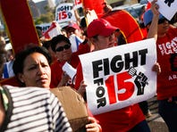 Protesters march outside McDonald's demanding increased minimum wage