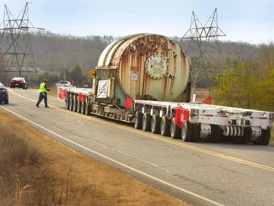 Workers removed extensive and transported three massive 110-ton condensers (pictured) during the cleanup.