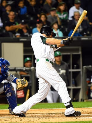 White Sox center fielder Jordan Danks (20) hits a RBI single during the fourth inning Sept. 25 at U.S Cellular Field. Credit: Mike DiNovo-USA TODAY Sports