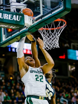 Miles Bridges,22, of MSU lays the ball in for 2 of 17 1st half points over Purdue defender Caleb Swanigan in the 1st half of their game Tuesday January 24, 2017 in East Lansing.  KEVIN W. FOWLER PHOTO