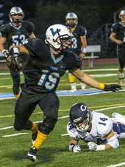Parsippany Hills running back Kevin Minardi (19) is