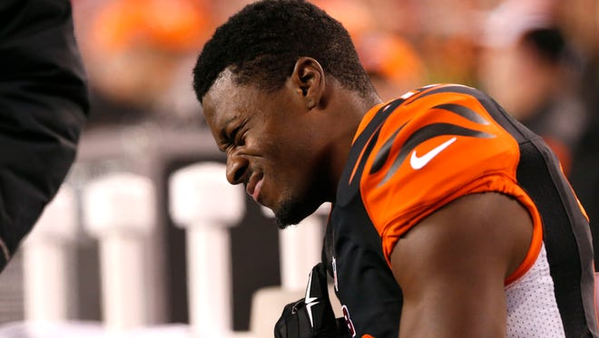 Cincinnati Bengals wide receiver A.J. Green grimaces in pain after coming out of the game in the first half against the Denver Broncos with a biceps injury.