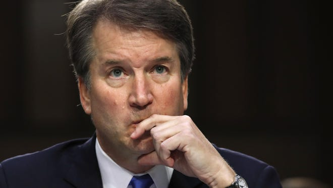 In this Sept. 5, 2018, file photo, President Donald Trump's Supreme Court nominee, Brett Kavanaugh listens to a question while testifying before the Senate Judiciary Committee on Capitol Hill in Washington.