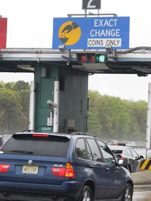 Drivers hed toward an exact-change lane at the Asbury Park Toll Plaza on the Garden State Parkway in a 2012 file photo.