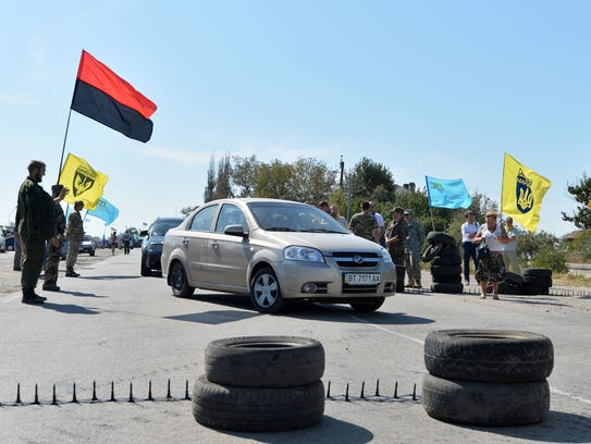 Activists block a road near  the border crossing point