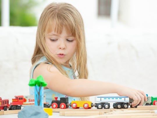 Audrey Firzherbert, 5, plays with a magnetic train set at the Railroad Museum booth on Saturday, June 9, 2018, during the Las Cruces Museum System Kick Off in the museum courtyard outside of Branigan Cultural Center.