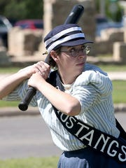 Danielle Brissette plays in a vintage baseball game during Fort Concho Frontier Day in 2016.