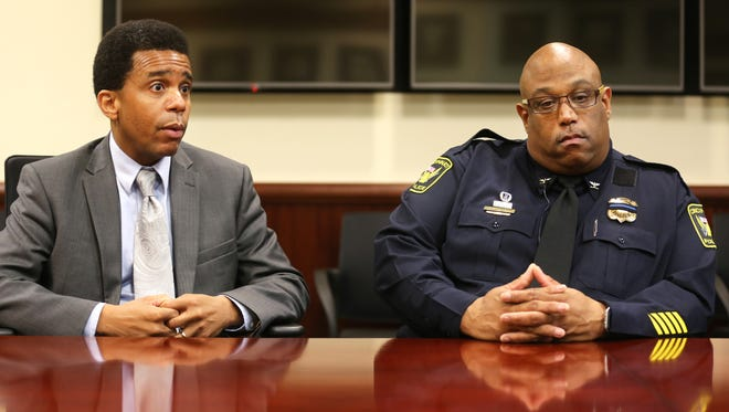 Cincinnati Police Chief Eliot Isaac, right, talks about the current mood of the police force in view of the recent police shootings in Dallas and Baton Rogue. At right is Chris Smitherman, City Councilman, chair of the Law & Public Safety Committee.