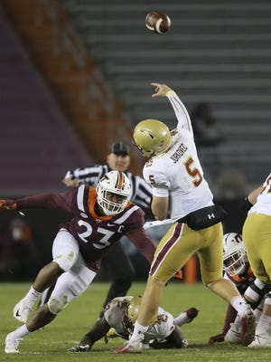 Boston College quarterback Phil Jurkovec throws as he is rushed by Virginia Tech's Rayshard Ashby in the fourth quarter of Saturday night's game in Blacksburg, Va.