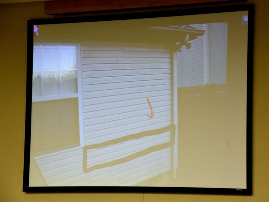 Photo showing where bullet went into Walker home and