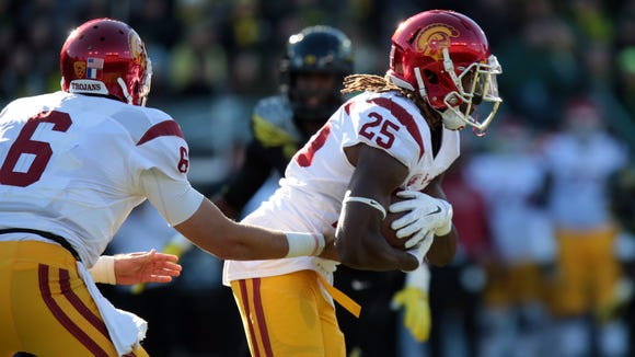 Nov 21, 2015; Eugene, OR, USA; USC Trojans quarterback Cody Kessler (6) hands the ball off to USC Trojans running back Ronald Jones II (25) against the Oregon Ducks at Autzen Stadium. Mandatory Credit: Scott Olmos-USA TODAY Sports