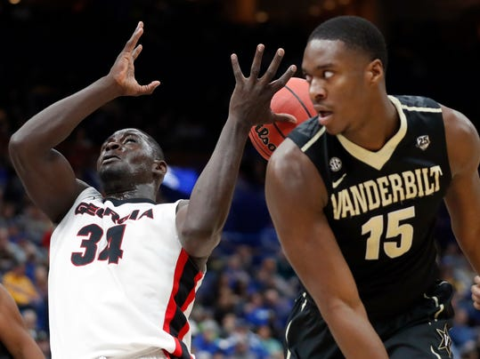 A rebound slips through the fingers of Georgia's Derek Ogbeide (34) as Vanderbilt's Clevon Brown (15) watches during the second half in an NCAA college basketball game at the Southeastern Conference tournament Wednesday, March 7, 2018, in St. Louis. Georgia won 78-62. (AP Photo/Jeff Roberson)
