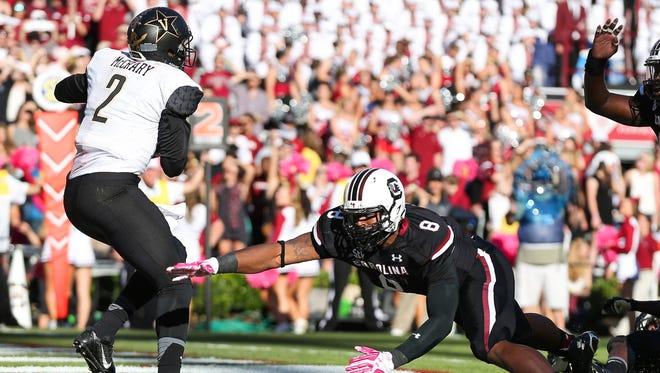 South Carolina defensive end Marquavius Lewis (8) pressures Vanderbilt  quarterback Johnny McCrary (2)  during the second quarter on Oct. 17, 2015.