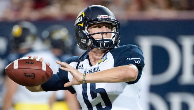 Sep 19, 2015: Northern Arizona Lumberjacks quarterback Case Cookus (15) warms up before the game against the Arizona Wildcats at Arizona Stadium.