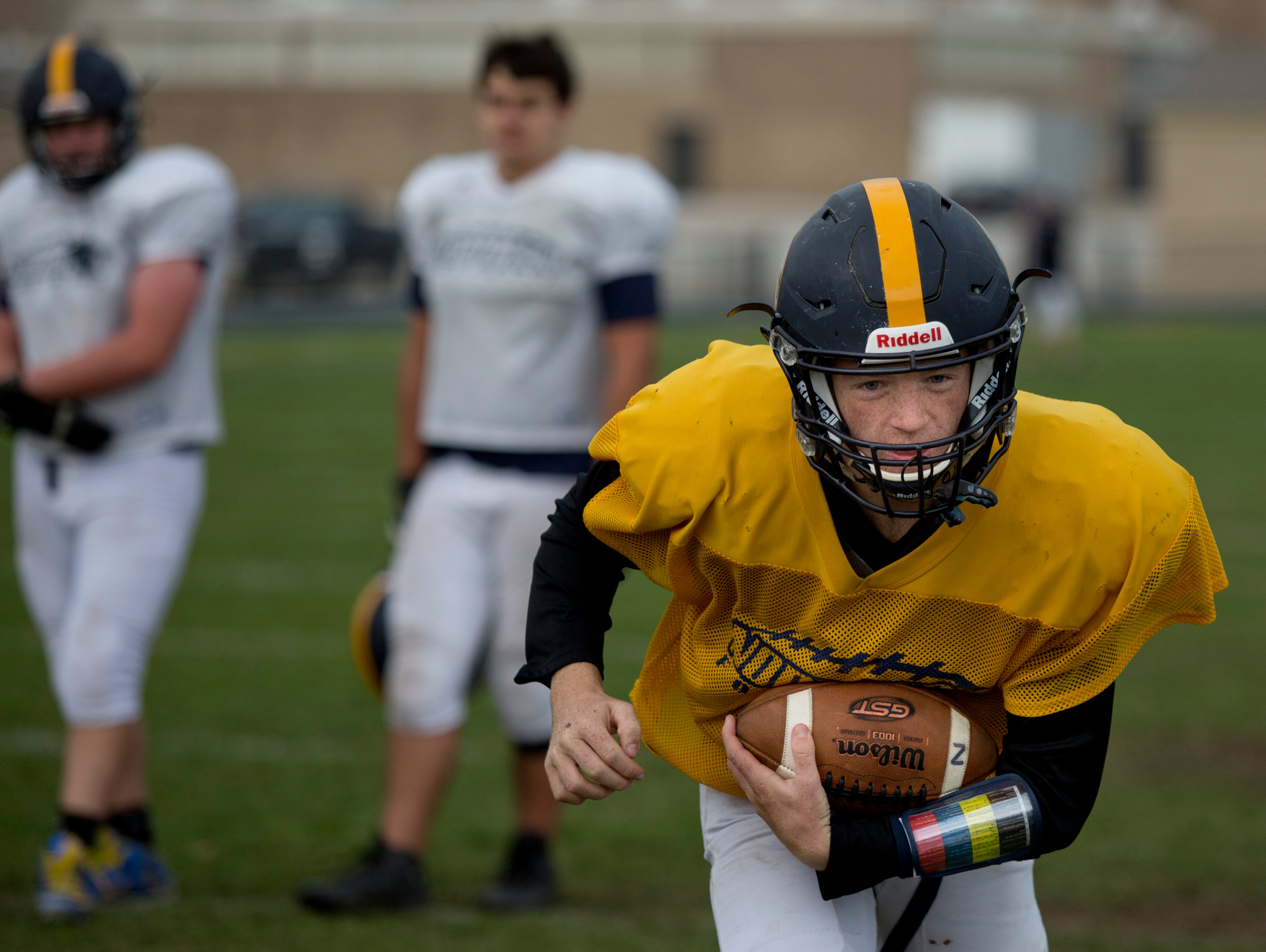 Junior Billy Fealko runs the ball during practice Wednesday, October 21, 2015 at Port Huron Northern High School.