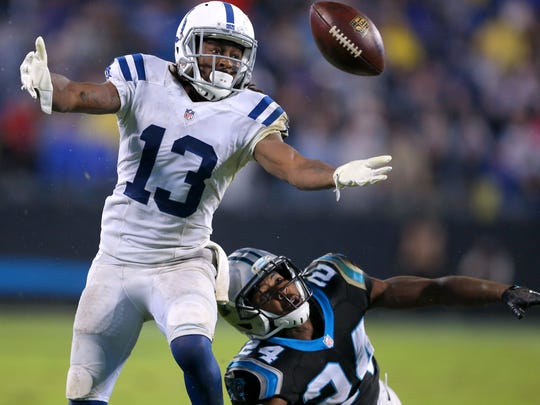 Indianapolis Colts wide receiver T.Y. Hilton (13) can't hold on to the pass as he's defended by Carolina Panthers cornerback Josh Norman (24) during the second half of an NFL football game Monday, Nov. 2, 2015, at Bank of America Stadium in Charlotte, North Carolina.