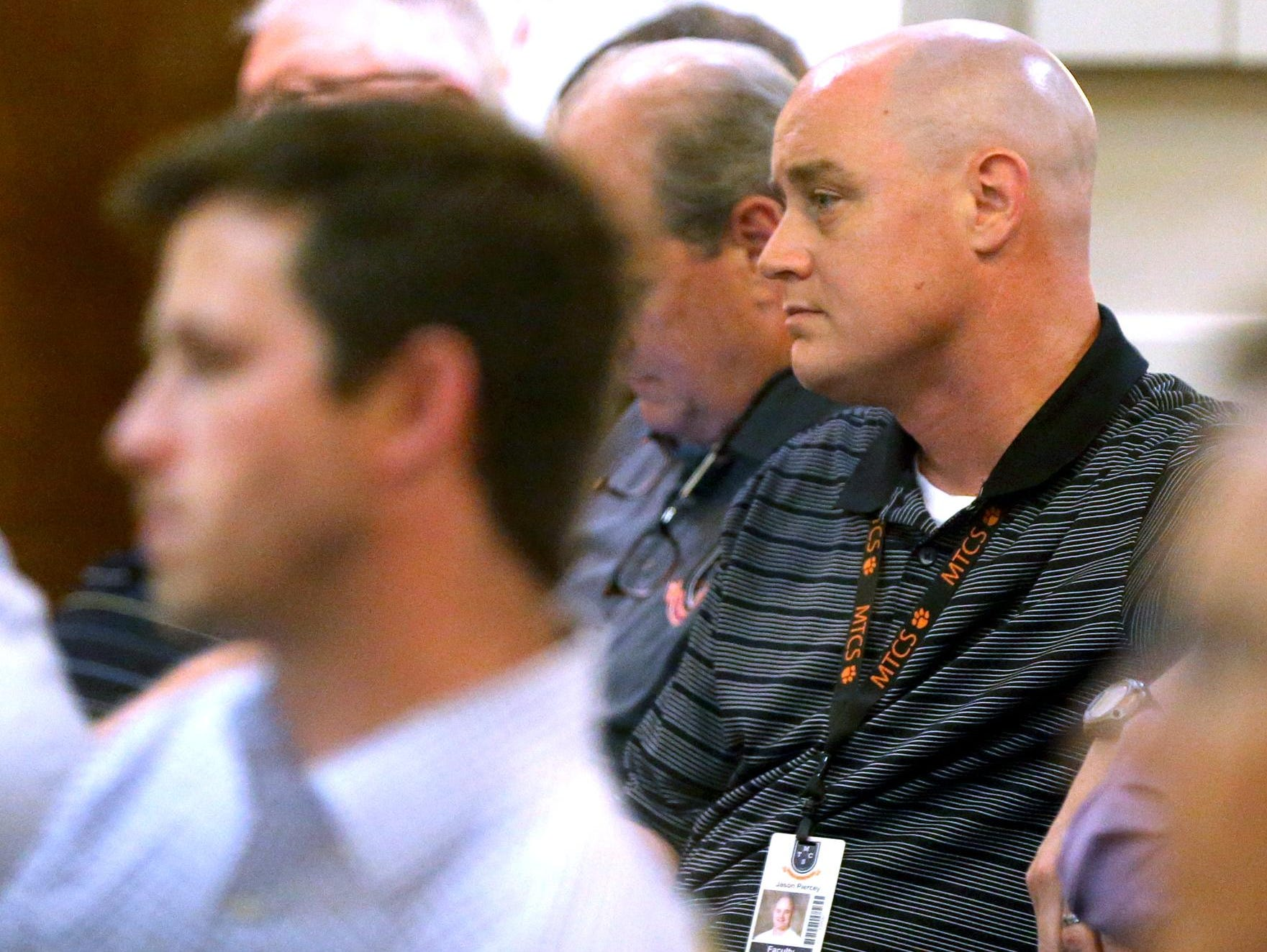 Jason Piercey, the boys basketball coach and athletic director for MTCS, listens in on the TSSAA Legislative Council meeting on Thursday.
