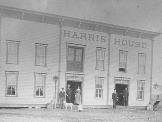"Another early-day hotel in Wichita Falls was the Harris House. According to an ad from the paper, it was owned by A.H. Harris and offered ""rooms specially fitted for traveling salesmen"" and was ""first-class in every particular!"" No date is included on the photo, but on the back of the image, it says the hotel was on Seventh Street where the FW&D (Fort Worth and Denver) Freight House once stood."