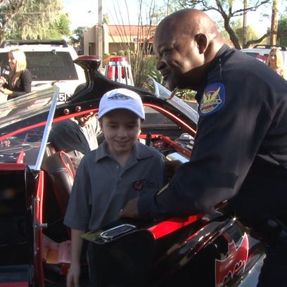 Tyson Copeland exits the batmobile after an honorary ride.