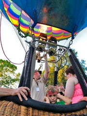 Andrew Chudacik, 6 of Binghamton. during his first time in the basket of a balloon while pilot Ryan Coy of Montrose, Pa. does a burn. Hot air balloons stayed grounded do to high winds during the Spiedie Fest & Balloon Rally held at Otsiningo Park in Binghamton on Saturday, August 6, 2016.   Thomas La Barbera / Correspondent Photo
