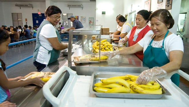 Department of Education cafeteria workers serve lunch at Ordot-Chalan Pago Elementary School.