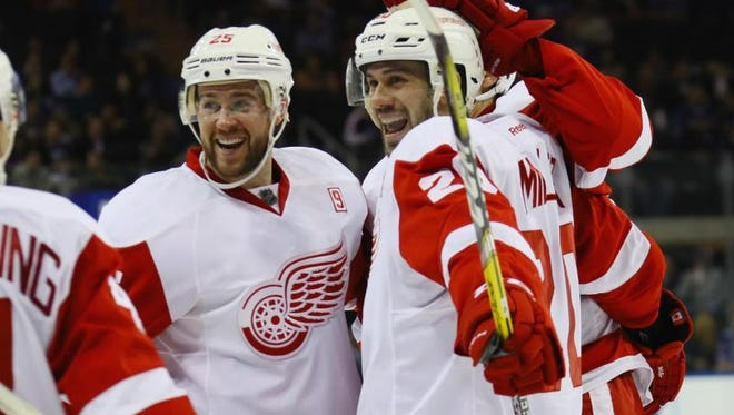 Wings forward Drew Miller, right, celebrates his game-winning goal at 53 seconds of the third period against the Rangers at Madison Square Garden on Thursday in New York.