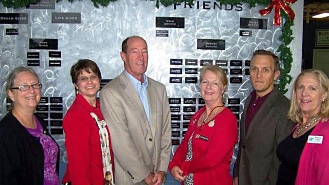 Dona Alexander (from left) of United Against Poverty;  Stefanie Myers, UAP executive director; Bob Calhoun of Rotary; Linda Sampson, president of Fort Pierce Rotary; John Wellborn of Rotar; and Bonnie Flint, director of philanthropy for UAP.