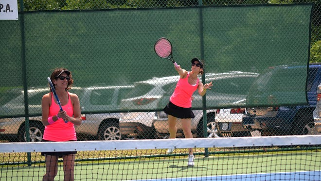 Janet Olliff and her sister Nancy Clark teamed to win the Pink Belles Northwest division of the 15th annual Pink Ribbon Tennis Tournament.