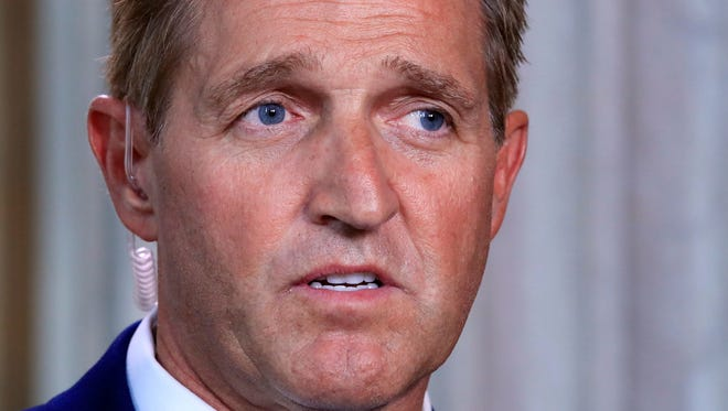 """Trump took his latest swing at Flake after the senator was caught on a hot mic Fridayby local television station ABC15 saying Republicans will be """"toast"""" if they become known as the party of Trump and Roy Moore."""