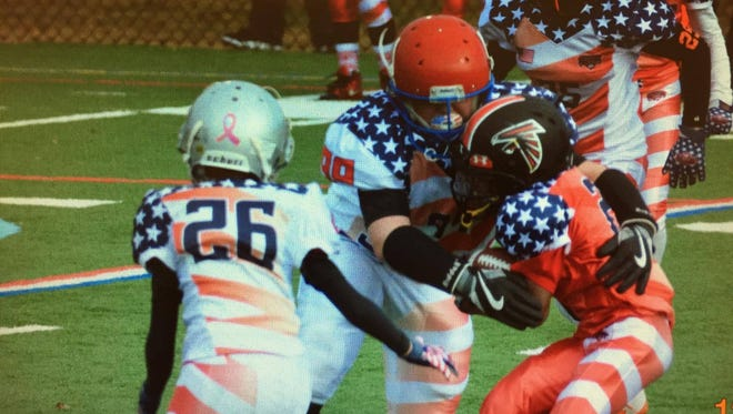 Zane Trace sixth grader Noah Fetters (red helmet) makes a tackle in last year's All-American Bowl on the east coast. Fetters has been invited to a similar event, this January, in Las Vegas.