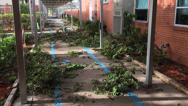 Lee County schools will be closed through Monday, and the district is still unsure how the days missed from Hurricane Irma will be made up. Here, yard debris covered the hallway at Franklin Park Elementary School, which staff quickly went to work on in the days following the storm.