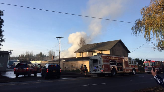 Smoke rises from the building which housed the Salem Speed Shop.