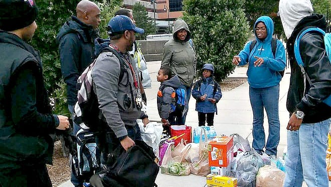 Each year, a local group called SITOO Dreams loads up its backpacks with packaged snacks/foods, water, soda, clothing items, hand warmers, etc, and walk the streets of Rochester for Operation Feed the Streets to help people in need.