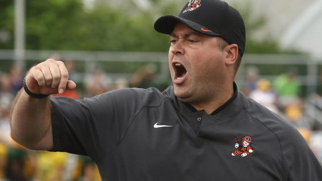 Massillon coach Nate Moore yells out from the sidelines during a 2018 scrimmage against St. Edward in Lakewood.
