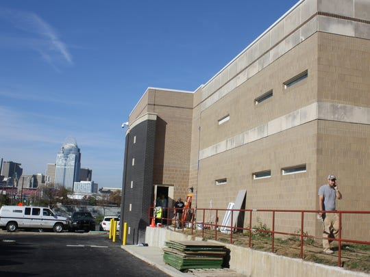 Cincinnati's skyline is within sight as construction workers finish 32 isolation cells as part of a $7.5 million expansion of Campbell County's jail in Newport.