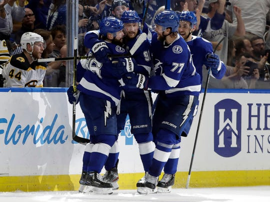 Tampa Bay Lightning right wing Nikita Kucherov (86) celebrates with teammates after scoring against the Boston Bruins.