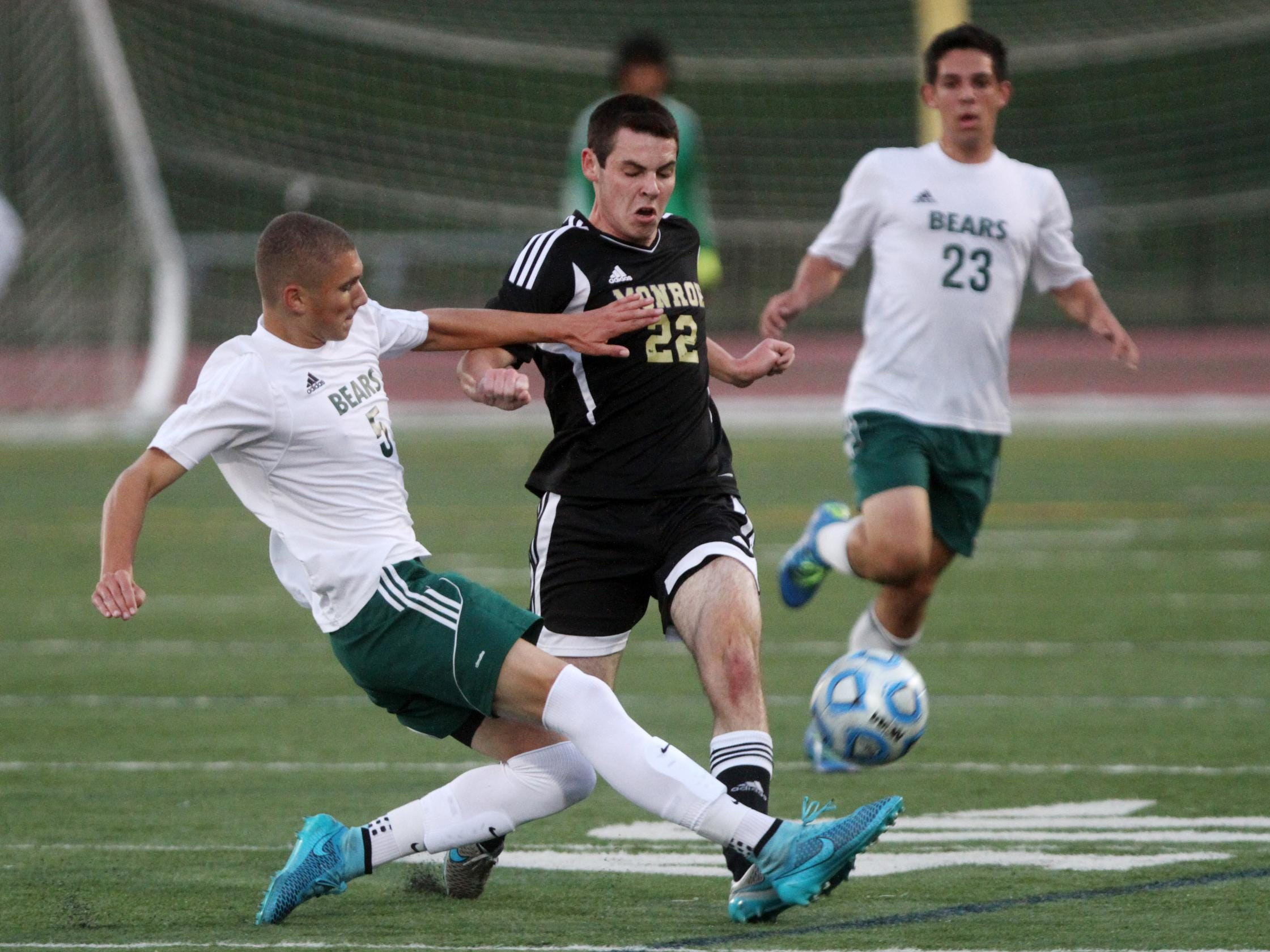 East Brunswick's Zachary Desrosier tackles Monroe's Ryan McCabe during the first half on Thursday in East Brunswick.