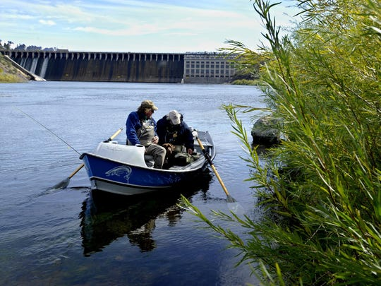 Bob Lay, front and Kevin Kniss prepare to leave the boat launch below Holter Dam for an afternoon fishing trip on the Missouri River in 2016,