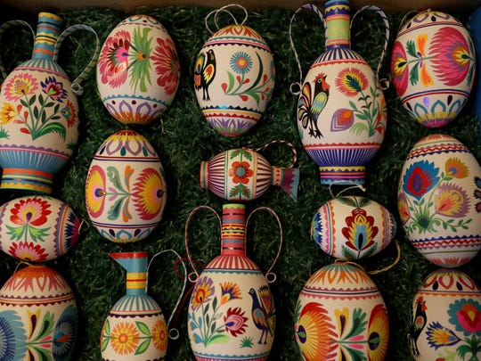 A display of some of Marcia Lewandowski's Easter egg decorating work. She uses wax, dyes and sometimes paper cutouts to make the designs.