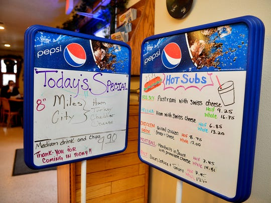 The specials board at the Montana Sub Shop changes