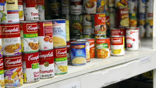 Canned goods are stacked in the pantry at the Central Brevard Sharing Center, one of 12 nonprofit organizations that received grants this year through Brevard County's community-based organization program.
