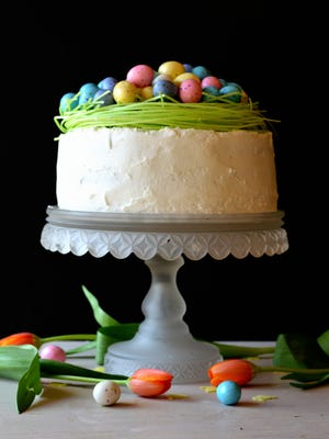 A bright white cake topped with a colorful candy nest is a sweet way to conclude Easter dinner.