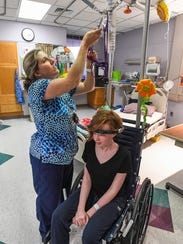 Shriners Hospital RN Manie Upton places 13-year-old Meredith Mozingo in traction at the hospital in Greenville on Monday, February 19, 2018, to help straighten her spine before surgery.
